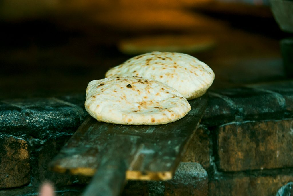 Flatbreads cooked in a fire