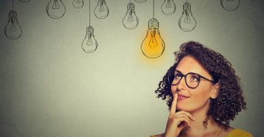 woman thinking with lightbulb above her head