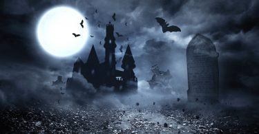 Dracula's house with full moon and bats